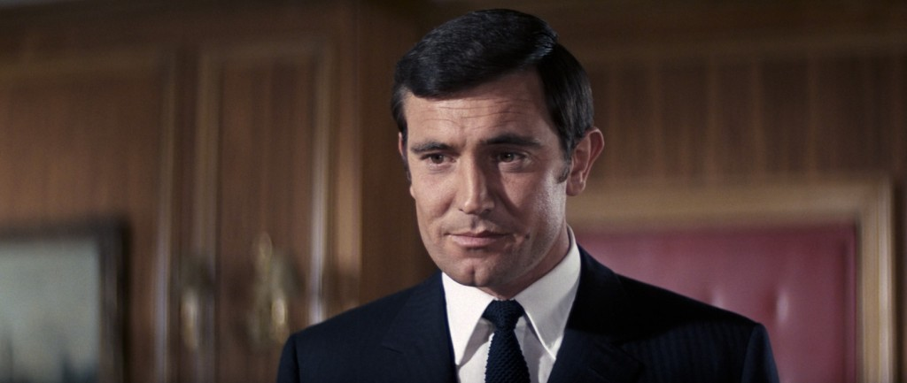 George Lazenby wears a point collar in On Her Majesty's Secret Service