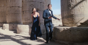 Roger Moore wears a midnight blue double-breasted dinner suit in The Spy Who Loved Me