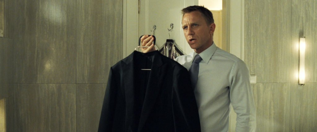 The dinner jacket deserves a better hanger than this. Always make sure your suits' shoulders have proper support when not in use.
