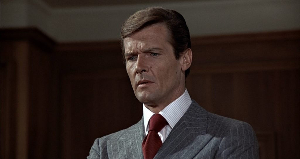 Roger Moore's first chalk stripe suit is grey with white stripes