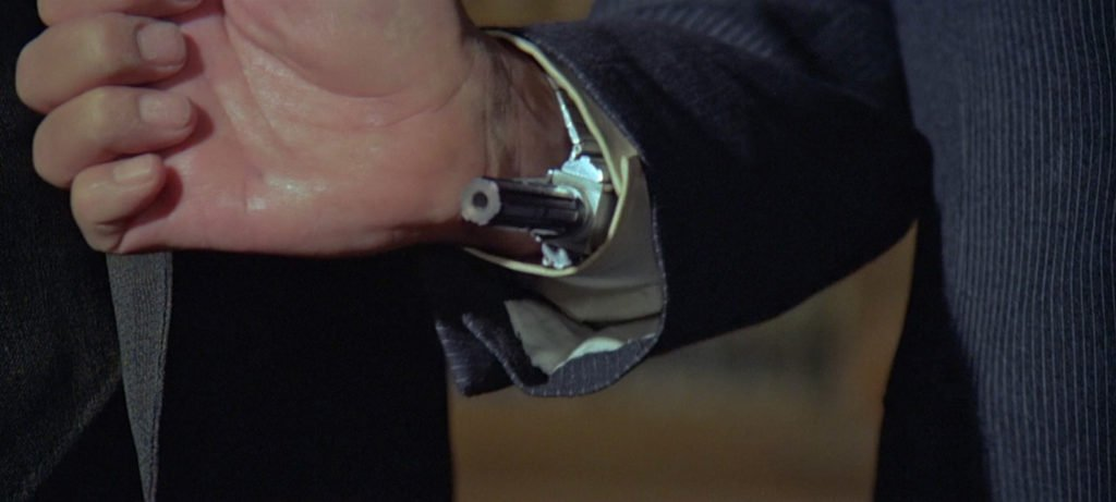 The pinstripes on Roger Moore's office suit in Moonraker are so close together that they can only be seen clearly in this close-up shot