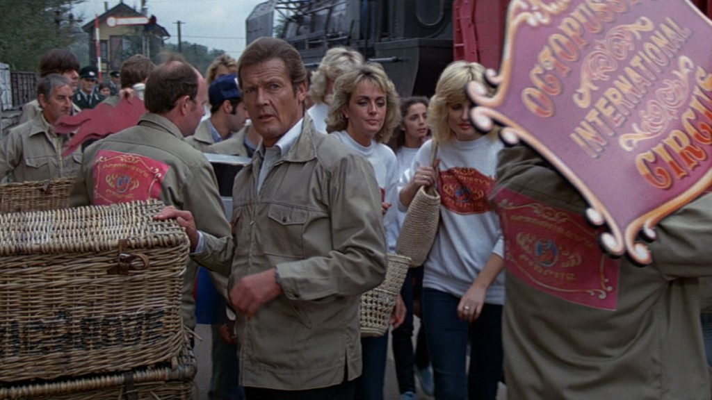 Bond abandons his suit coat and dons an Octopussy Circus jacket to fit in