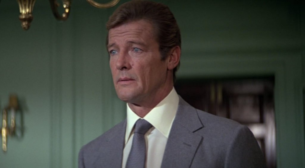 Roger Moore wearing a cream shirt in For Your Eyes Only