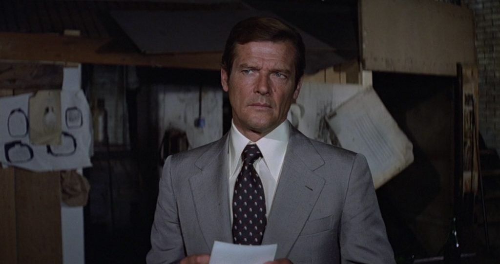 Roger Moore wearing a very cream shirt in Moonraker