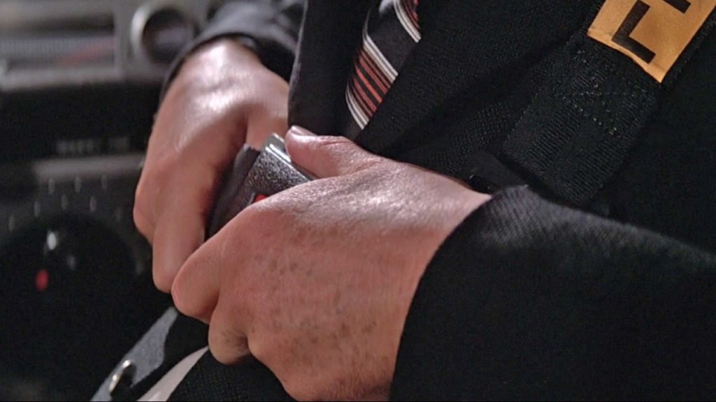 The close-up shows the more intricate stripes on the tie as well as the blazer's hopsack texture.