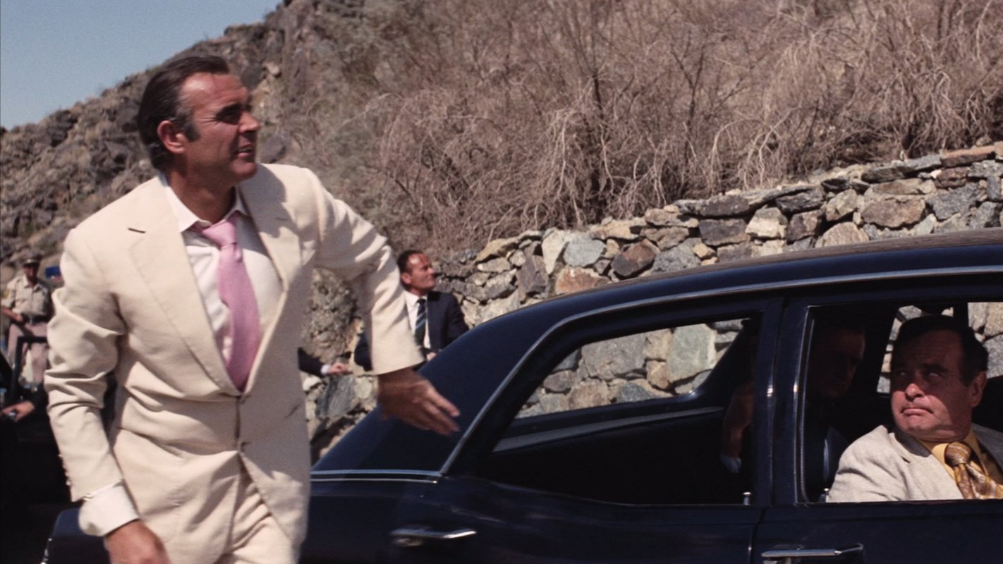 1b7ae062ce2eb The Cream Linen Suit and Pink Tie in Diamonds Are Forever – The ...