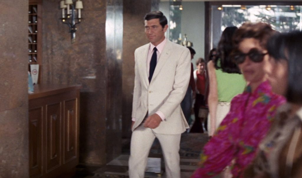 George Lazenby in a cream suit made by Dimi Major