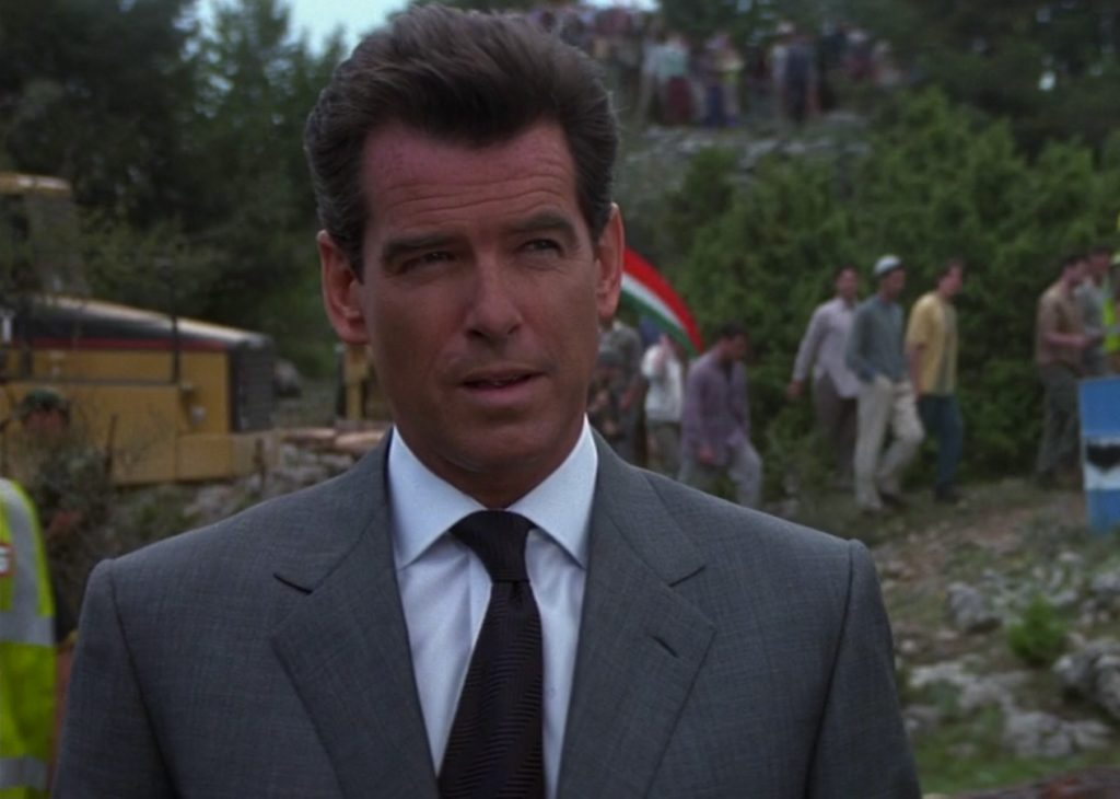 A Brioni suit jacket with roped sleeve heads on Pierce Brosnan in The World Is Not Enough
