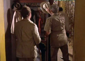 Back of the safari jackets: Roger Moore, left; Gregory Peck, right