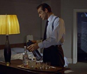 Bond fastens his shoulder holster down to his side-adjuster