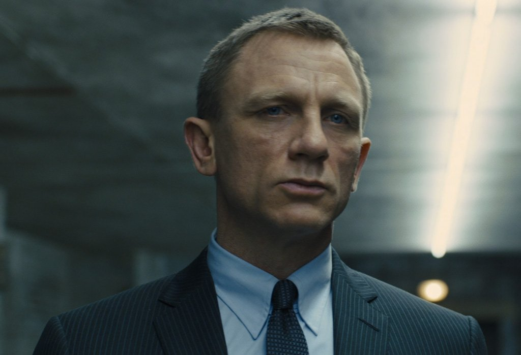 Daniel Craig wears a charcoal suit with grey rope stripes in Skyfall