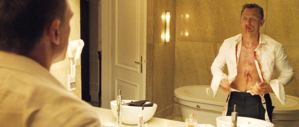 Daniel Craig wearing trousers double reverse pleats Pierce Brosnan wearing trousers double reverse pleats