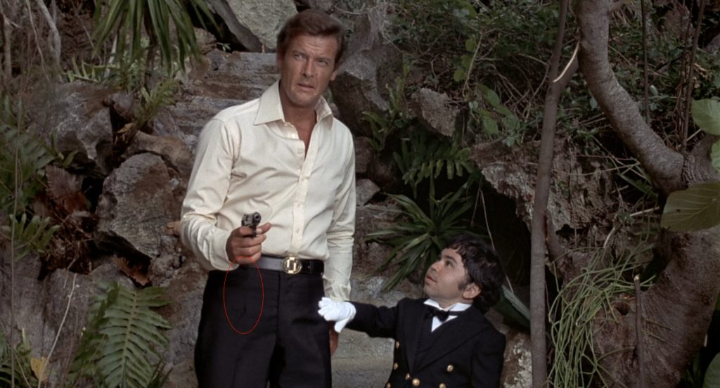 Darts on the front of Roger Moore's trousers, in-line with the crease