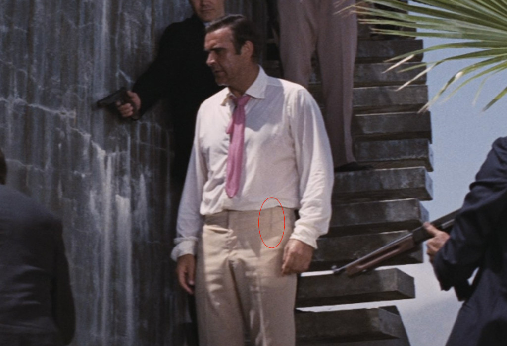 Darts on the front side of Sean Connery's Anthony Sinclair trousers in Diamonds Are Forever. They are easier seen when wet. Click the image for a close look.
