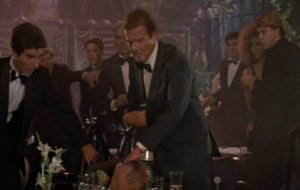Roger Moore's double-breasted dinner suit has a low button stance that allows easy access to his PPK