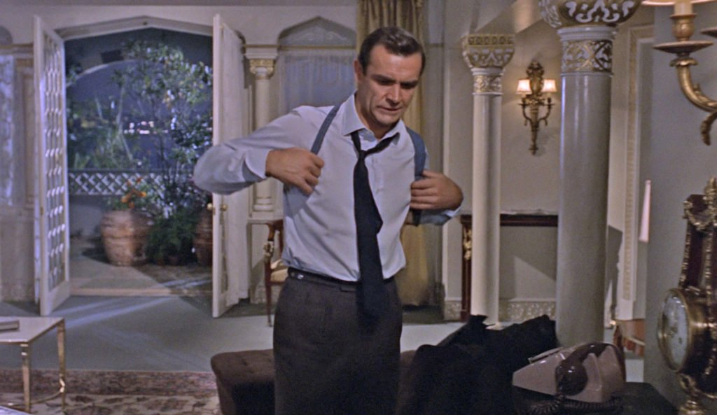 Connery in trim-fitting forward-pleat trousers in From Russia with Love