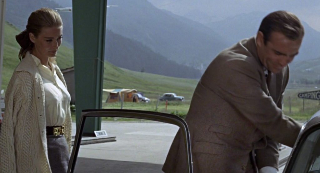 Slanted pockets with a ticket pocket on Sean Connery's hacking jacket in Goldfinger. Notice that the ticket pocket has a smaller flap than the hip pocket and is placed high above it.