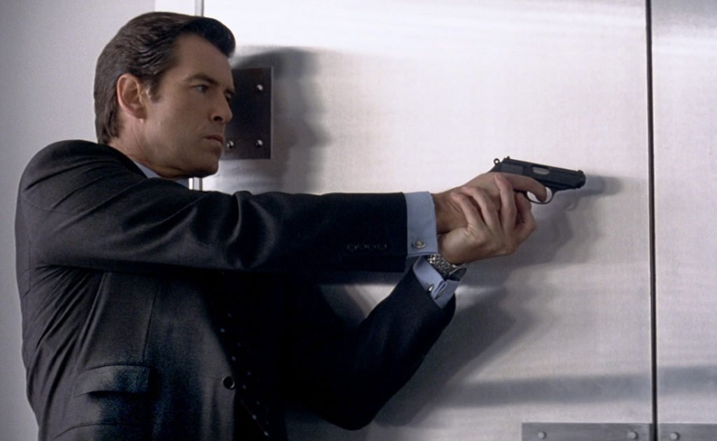 Slanted pockets with a ticket pocket on Pierce Brosnan's charcoal worsted flannel suit in Tomorrow Never Dies