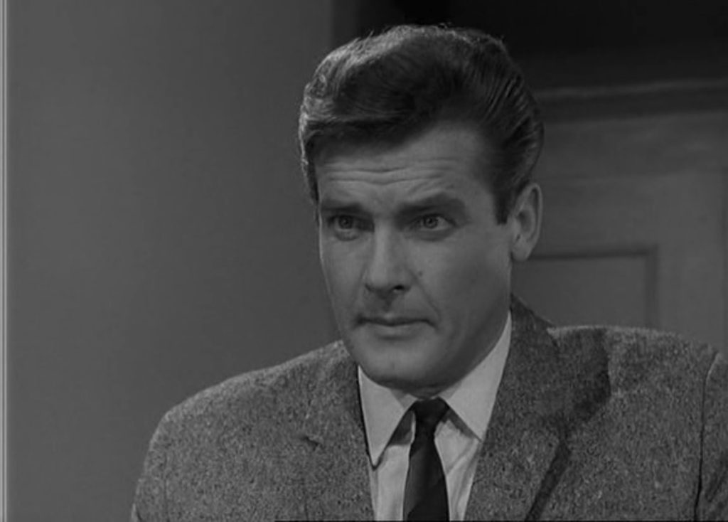 The grey tweed jacket in Luella in the scene where Bond whispers to a woman that he is James Bond