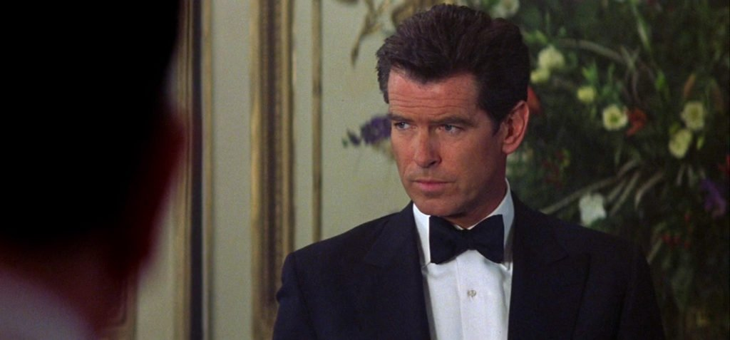 Pierce Brosnan wearing a midnight blue dinner jacket in The World Is Not Enough