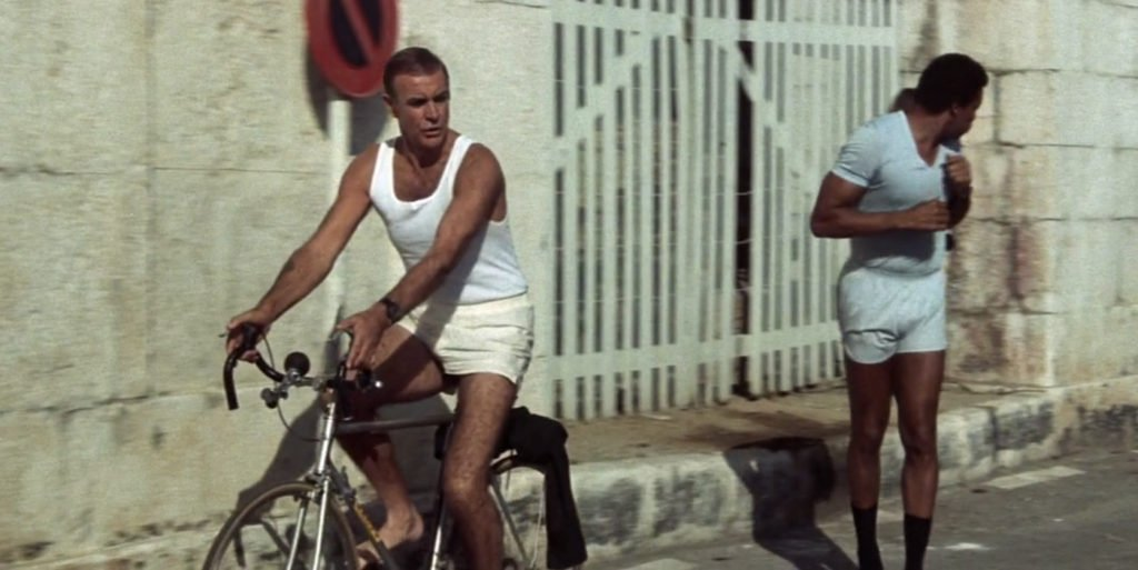 Sean Connery wearing cream boxer shorts and a white vest in Never Say Never Again