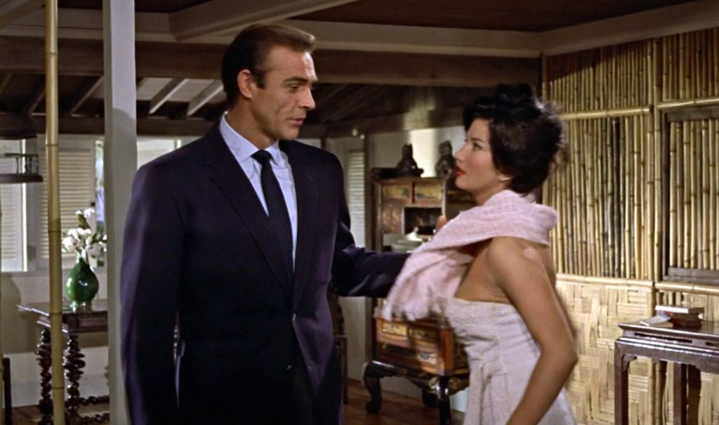 Bond wears a navy blazer on his date with Miss Taro